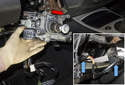 Remove the steering column by sliding it up and out the hole in the instrument panel (red arrow).