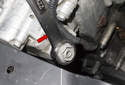 Using a 22mm wrench, loosen the VANOS pressure relief valve (red arrow).