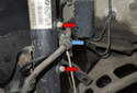 Working at front strut, pull brake hose (blue arrow) out of the holder.