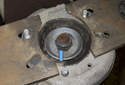 Remove the 24mm nut (blue arrow) from spring top by counter holding center shaft with a 6mm Allen bit.