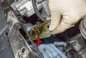 Remove the VANOS solenoid gasket (red arrow) from the VANOS actuators, it will pull off.