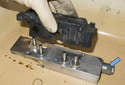 Remove the electrical solenoid from the block.
