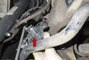 Rotate the sensor (red arrow) toward the left side of the vehicle and angle it up as you remove it from the body.