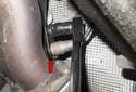 B2S2: Using an oxygen sensor socket with a universal adapter (red arrow), loosen the oxygen sensor.