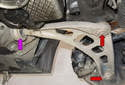 The control arm has three areas of trouble: The ball joint that connects to steering knuckle, the ball joint that attaches to subframe (red arrows) and the control arm bushing (purple arrow).