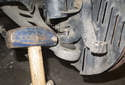 Then separate the ball joint from the steering knuckle using a pickle fork or a swift blow from a hammer.