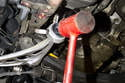 When installing the new control arm; first, install the subframe ball joint nut finger tight.