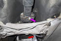 Working at the transmission, remove the six, 16mm driveshaft flex-disc fasteners (purple arrow).