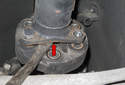 Lever the driveshaft out of the flex-disc (red arrow).