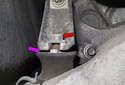 Working at the transmission cross member, loosen the two 13mm transmission mount nuts (red arrow).