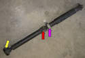 BMW uses a two piece driveshaft with a center bearing (purple arrow) supporting the middle of the shaft.