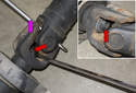 With a wrench loosen the 18mm bolt (red arrow) that holds the driveshaft halves together.