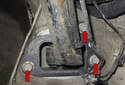 Then remove three trailing arm 18mm fasteners (red arrows).