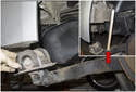 Pull trailing arm down away from body and place a block of wood (red arrow) between trailing arm and body.