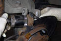 Assemble ball joint tool to extract ball joint from wheel bearing carrier.