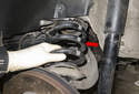 Remove rear coil spring (red arrow).