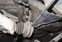 Pull the drive axle down and away from the rear differential.