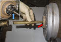 Next, remove the drive axle from the wheel hub.