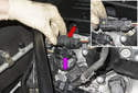 Locate the oxygen sensor electrical connectors at the rear of the cylinder head.
