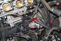 Slide the starter out of the bell housing toward the radiator (red arrow).