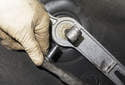Remove the shift rod linkage from the shifter.