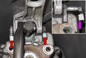 Working at the transmission, remove the mounting clips for the shift support (red arrows).
