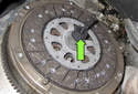 Install and center clutch disc using alignment tool (green arrow).
