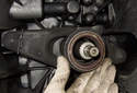 Remove the throwout bearing by sliding it off the transmission output shaft.