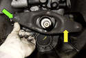 Then remove the clutch fork (yellow arrow) by releasing the spring retaining clip (green arrow).