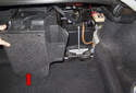 Lift carpet trim (red arrow) and remove from the trunk by sliding it straight out toward the left side of the vehicle.