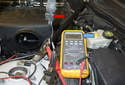 Next, connect two jumper wires with insulated spade terminals to the crankshaft position sensor terminals (red arrows).