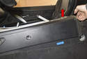 Using a plastic prying tool, gently lever out the rear vent trim panel of the center console.
