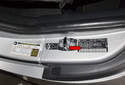 The VIN is also located on the driver door jamb, vehicle identification sticker (red arrow).
