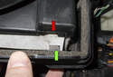 When installing the lid, start by inserting the tabs (green arrow) into the slots (red arrow) in the housing.