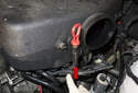 Pull the dipstick tube (red arrow) sway from the intake manifold.