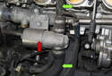 With the manifold removed, you have clear view of the idle control valve (red arrow) and the connecting hoses (green arrows) to the intake manifold and air tube.