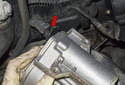 Next, disconnect the second electrical connector by pressing the wire retainer (red arrow) and pulling it straight off.
