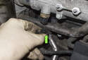 First, disconnect the coolant temp sensor electrical connector (green arrow).