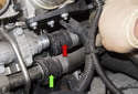 Pull the upper hose off the coolant pipe (red arrow).