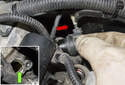Intake camshaft sensor: Remove the camshaft sensor from the cylinder head (red arrow).