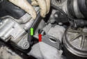 Next, open and unclip (red arrow) the wire harness mount and remove the harness (green arrow) from the mount.