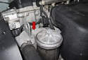 BMW Z4 S54 6-cylinder models utilize a mechanical water pump, mounted below the thermostat (red arrow).