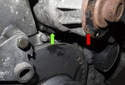 Next, remove the bottom 10mm water pump (red arrow) mounting fastener (green arrow).