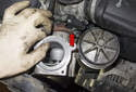 Rotate the water pump pulley toward the engine (red arrow).