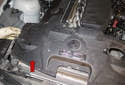 Lift the radiator support trim in the direction of the red arrow to remove it.