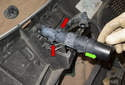 Then lever the retainers up (red arrows) and slide the headlight washer out (green arrow).