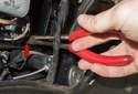 Turn Signal Bulb: Once unlocked, use needle nose pliers to grab and remove it from the headlight.