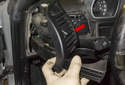 Slide the vent with the cup holder (red arrow) out of the dashboard.