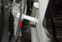 Next, unclip the window regulator cable from the mount (red arrow) inside the door.
