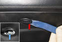 Next, use a plastic prying tool to remove the airbag fastener cap (red arrow).